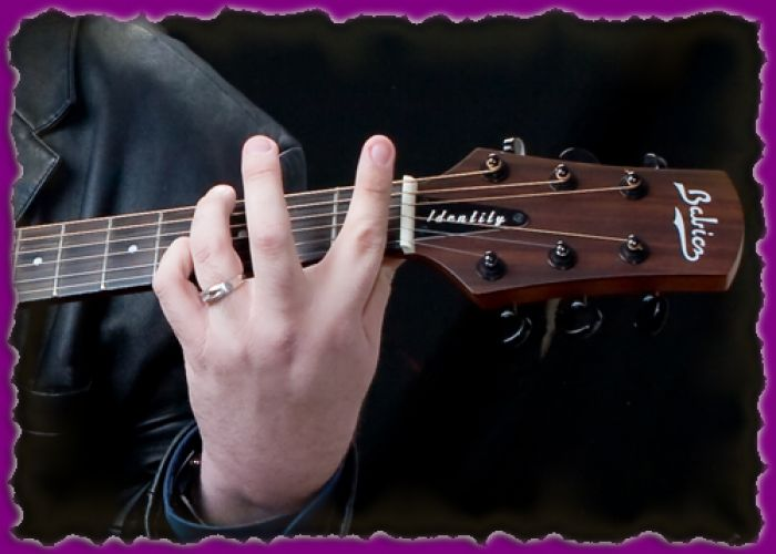 joey-stuckey hand on guitar neck