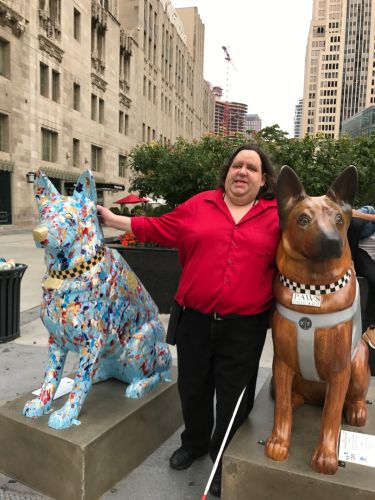 Joey with the K9 Cop statues on the Magnificent Mile in Chicago