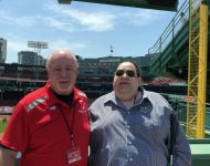 Bob with Joey on top of Green Monster in Left Field at Fenway Park