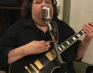 Joey singing into Elvis mic at Sun Studio